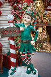 Christmas Elf and North Pole sign Stock Photo