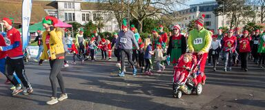 Christmas elf parade Stock Images