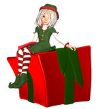 Christmas Elf with present Stock Images