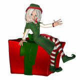 Christmas Elf with present Royalty Free Stock Photo