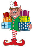 Christmas Elf With Presents. Smiling Christmas elf carrying presents that are ready for delivery Stock Photo
