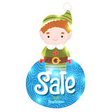 Christmas elf with sale label Royalty Free Stock Image