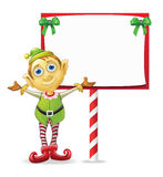 Christmas Elf with Sign. Christmas Elf in Front of a Holiday Sign Stock Images