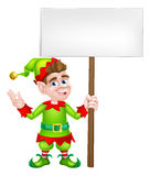 Christmas Elf Sign. An illustration of a cute happy cartoon Christmas Elf or one of Santa s Christmas with a sign board helpers Royalty Free Stock Photos