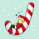 Christmas Elf Sleeping on Candy Cane Royalty Free Stock Photo