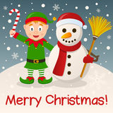 Christmas Elf & Snowman on the Snow Stock Image