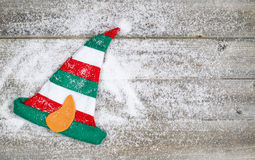 Christmas Elf Stocking on rustic wood with snow Royalty Free Stock Images