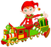 Christmas Elf and Toy Train Royalty Free Stock Photography