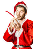 Christmas elf writing to do list for Santa Royalty Free Stock Photos