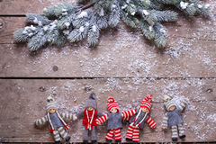 Christmas elfs  and branches fur tree on aged wooden background Stock Image