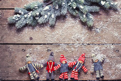 Christmas elfs  and branches fur tree on aged wooden background Royalty Free Stock Image