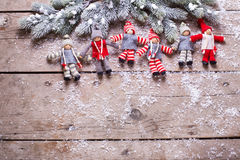 Christmas elfs  and branches fur tree on wooden background. Royalty Free Stock Image
