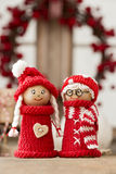 Christmas elfs. Two wooden christmas elves in red knitted outfits Stock Photos