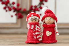 Christmas elfs. Two wooden christmas elves in red knitted outfits Royalty Free Stock Photo