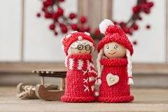 Christmas elfs. Two wooden christmas elves in red knitted outfits Royalty Free Stock Photos