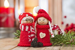 Christmas elfs. Two wooden christmas elves in red knitted outfits Stock Images