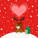 Christmas Elk. Christmas theme. Cute Rudolph holding a love letter. Speech heart bubble Stock Photo