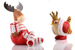 Christmas elk with bird. Royalty Free Stock Images