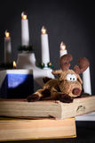 Christmas Elk and books Royalty Free Stock Photography