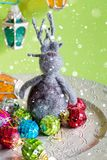 Christmas elk and toys. On the big plate over snow royalty free stock photos