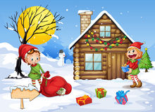 Christmas elve and house Royalty Free Stock Photo