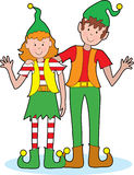 Christmas Elves. A pair of happy Christmas elves waving A pair of happy Christmas elves waving Royalty Free Stock Image