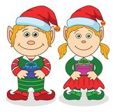 Christmas elves, boy and girl Stock Photography