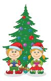 Christmas elves and fir tree Royalty Free Stock Photography