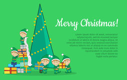 Christmas Elves packing presents near tree Royalty Free Stock Photo