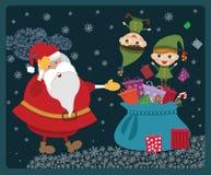 Christmas elves with Santa Royalty Free Stock Photos