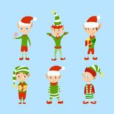Christmas elves set. Funny cartoon creatures in green outfits stock illustration
