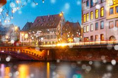 Christmas embankment in Strasbourg, Alsace. Picturesque Christmas quay with mirror reflections in the river Ile during evening blue hour, Strasbourg, Alsace Royalty Free Stock Photography