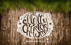 Christmas emblem on wooden texture Stock Photography