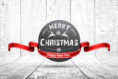 Christmas emblem on wooden texture Royalty Free Stock Photography