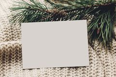 Christmas empty card. blank christmas note or wish list on styli. Sh simple knitted sweater with fir for christmas holidays. eco design. xmas  seasonal greetings Stock Photo