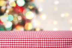 Christmas empty table checkered tablecloth.Food display background. Christmas product display background.Checkered rep picnic tablecloth empty space backdrop stock photos