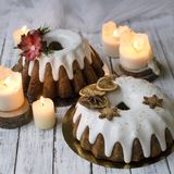 Christmas English fruitcake with candied fruit, dried fruit and nuts, decorated with white icing on a wooden background royalty free stock photos