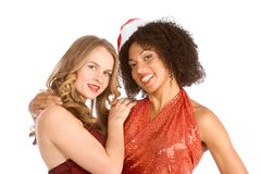 Christmas ethnic Latina Mrs. Santa Claus friend. Two lesbian friend lovers female one Caucasian and second ethnic Latina in Mrs. Santa Claus are in friendly hug Royalty Free Stock Photography