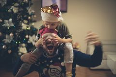 Christmas euphoria and fun. Father and daughter at home for Christmas day stock photos