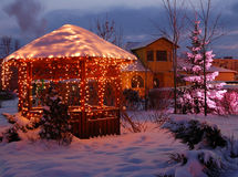 Christmas Eve. Park under snow with garlands decoration Royalty Free Stock Photography