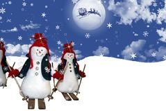 Christmas Eve. Snowmen skiing down a snowy slope as Santa flies in the moonlight stock illustration