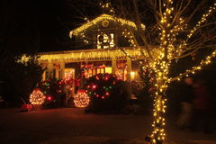 Christmas Eve. A brightly lit home ready for the morrow`s festivities Stock Photo