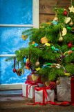 Christmas eve in cozy rustic cottage Royalty Free Stock Images