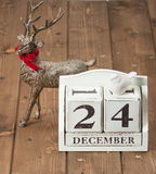 Christmas Eve Date On Calendar. December 24. Reindeer Wooden Background royalty free stock photos