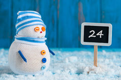 Christmas Eve Date On sign. December 24. Snowman. Near direction Sign. Xmas Decorations royalty free stock photo
