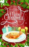 Christmas Eve dinner banner with gift and fish. Christmas Eve dinner greeting card with gift and baked fish. Stuffed carp and present box on festive table Royalty Free Stock Photo