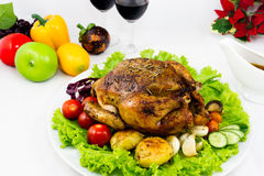 Christmas eve dinner. Roasted chicken with potato, tomatoes, and red wine for Christmas dinner Royalty Free Stock Images