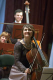 Christmas Eve. DNEPROPETROVSK, UKRAINE � DECEMBER 24: Cellist Olga Shutko and Academic Symphony Orchestra perform CHRISTMAS EVE at the Philharmonic on stock photo
