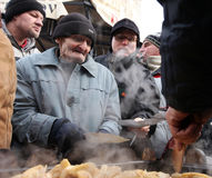 Free Christmas Eve For Poor And Homeless On The Central Market In Cracow Stock Photos - 50659503