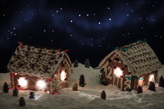 Christmas eve in the gingerbread village Royalty Free Stock Image